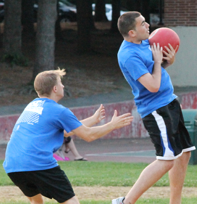 BSSC Kickball Player in blue catches a kick for an out